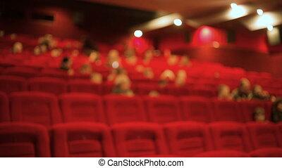People at the cinema watching movie