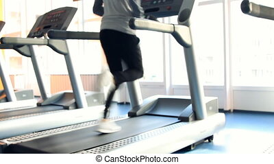 People at the gym exercising. Run o