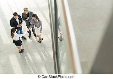 People at the hall in office building
