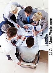 People at work - Above view of business partners sharing...