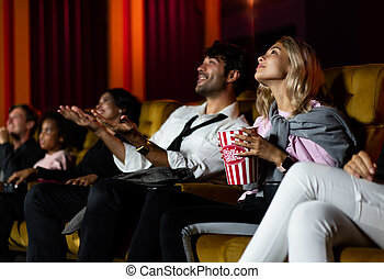 People audience watching movie in cinema theater.