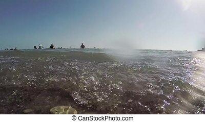 People bathe in the sea. Waves splash slow motion video sea water