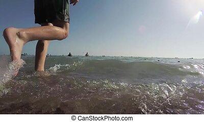 People bathe in the sea. Waves splash slow motion video water