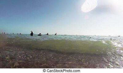 People bathe in the sea. Waves splash water slow motion video