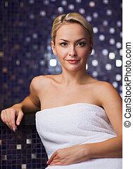 beautiful young woman sitting in bath towel
