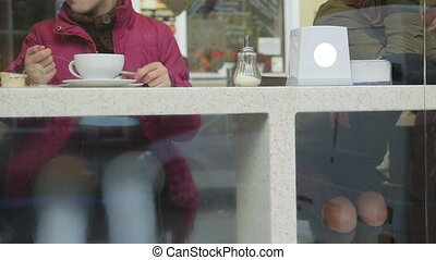 People behind the window glass at coffee shop