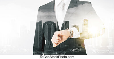 close up of businessman with wristwatch