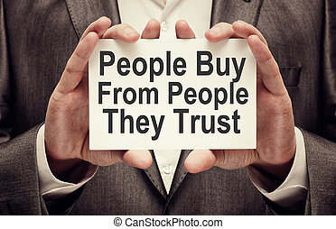 People Buy From People They Trust. Businessman holding a...