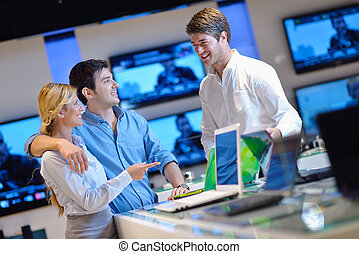 people buy in consumer electronics store - people in...