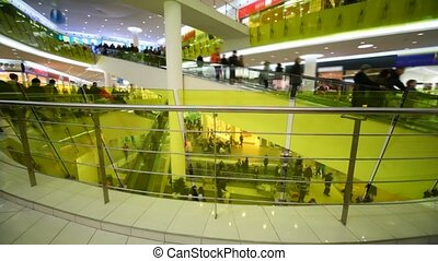people buyers crowd rushing on escalators in mall shop