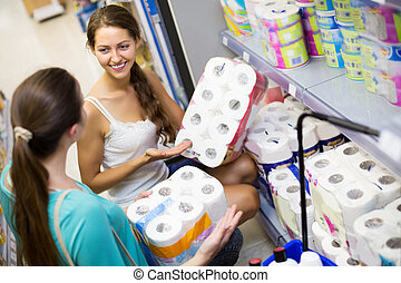 Positive young people buying bath tissue in the shopping mallin the shopping mall