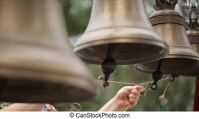 People call in brass bells pulling ropes which connected with its tongues