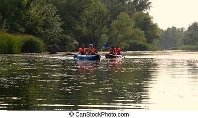 People canoe paddle a sunny day. Slow motion - People in...