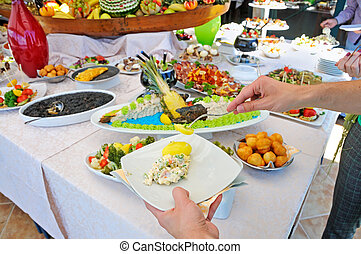 People catering buffet food outdoor