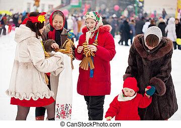 People celebrating  Shrovetide  at Russia