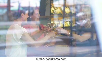 women drinking wine at restaurant or bar - people,...