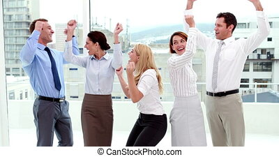 People cheering at the camera - Business people cheering at...