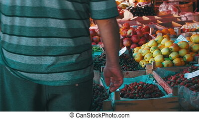 People Choose Vegetables on the Grocery Market