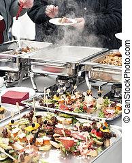 People choosing food from buffet
