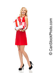 happy young woman in red dress holding gift boxes