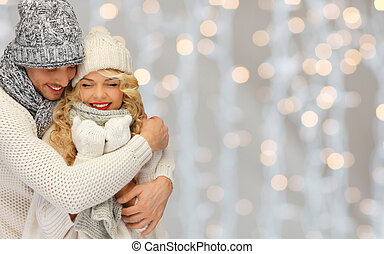 happy family couple in winter clothes hugging - people,...