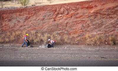 People Cleaning Garbage High Angle - High angle shot of a...