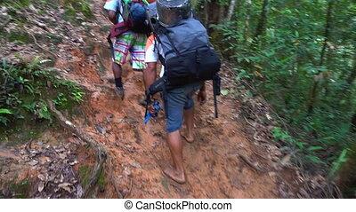 People climbing a mountain - A medium shot of people...