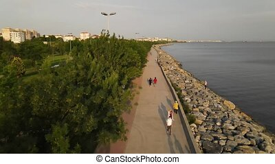 People Coastal Walking Aerial Drone