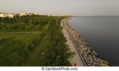 People coastal walking park aerial view