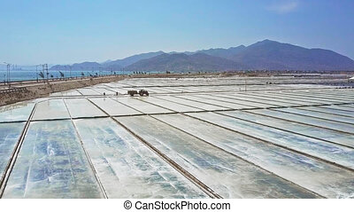 People Collect Salt on Huge Plantations to Export - panorama...