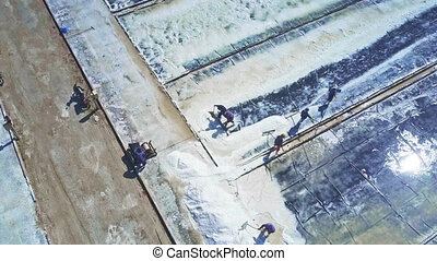 People Collect Salt with Tools against Sunlight - panorama...