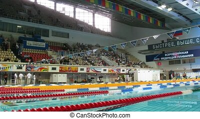 People come and take seats in places before competitions on swimming