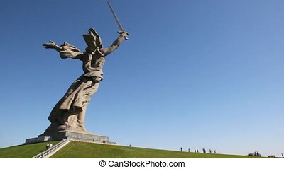 People come nearer to a monument of Native land-mother. -...