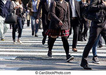 People commuting in rush hour at zebra crossing,Tokyo japan