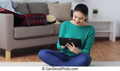woman with tablet pc at home - people concept - happy young...
