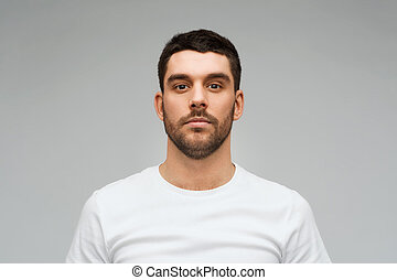 young man portrait over gray background