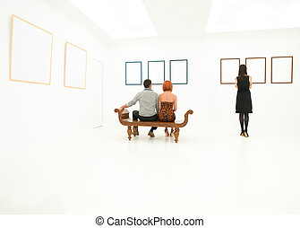 people contemplating artworks