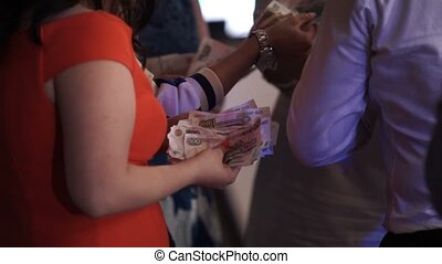 People counting money in hands shot