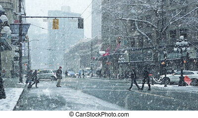 People Cross City Road In Snowstorm