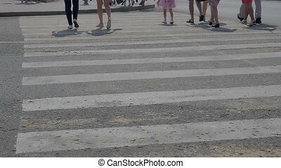 People cross the road on a pedestrian crossing. Close-up...