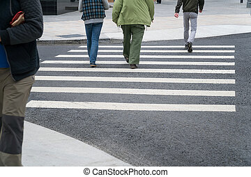 People cross the road on a pedestrian crossing
