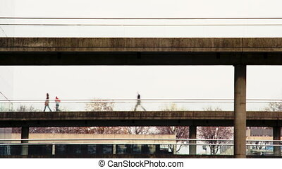 people crossing a bridge in paris, france