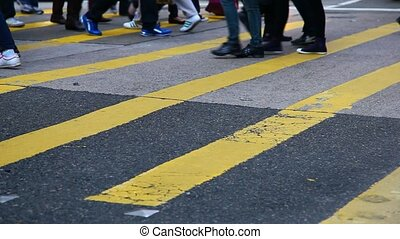 People crossing city street - Rush hour in Hong Kong. People...