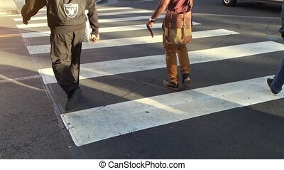 People crossing street. Crowded crosswalk