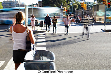People crossing the road at the foot-crossing.