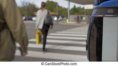 People crossing the road on zebra