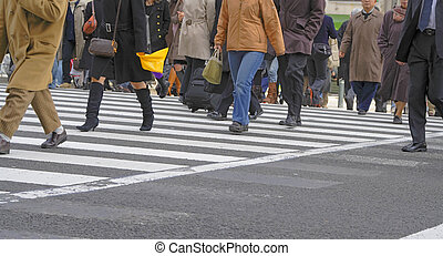 People crowd crossing the street in a city-frontal view.