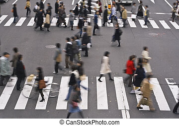 People crossing the street - Group of people crossing the...