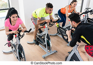 People cycling in gym