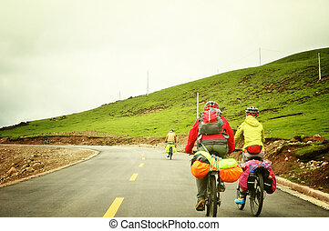 people cycling on tibet mountain